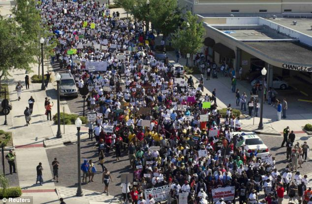 Demonstration: Thousands of people march down Park Avenue Monday in support of Trayvon Martin at downtown Sanford, Florida