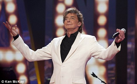 The show must go on! Barry Manilow revealed he would collapse into a wheelchair after his shows