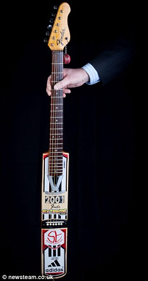 Stripped back: Tom's 'oilcan' guitar inspired by a Castrol oilcan, and his cricket bat instrument are two more guitars from his incredible collection