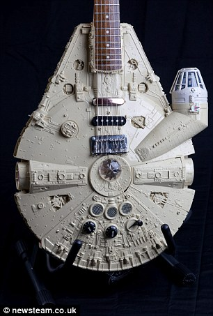 Millenium Full-strum: Tom's Millenium Falcon guitar took three months to make using a 140-piece kit of the famous Star Wars craft