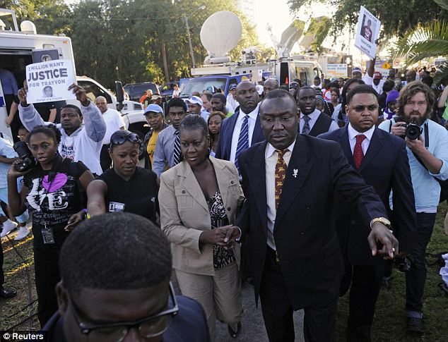 Frenzy: Trayvon's mother, Sabrina Fulton (center), seen next to her lawyer Benjamin Crump, attended the massive rally on Monday that was organized in Sanford to show support for Trayvon