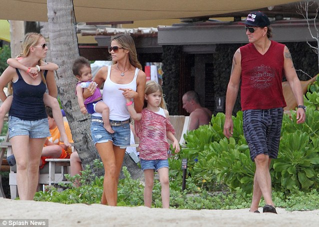 Rekindled romance? Denise Richards and her daughters Sam, Lola and baby Eloise have joined her former lover Richie Sambora for a holiday in Hawaii