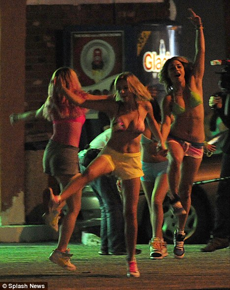Breaking their good-girl moulds: Ashley and her co-stars play a group of friends who rob a restaurant to fund their fun-filled Florida spring break