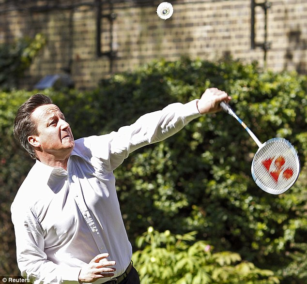 Determination: The Prime Minister focuses grimly on a shot but he then rather spoiled the effect by asking: 'How does the scoring work?'