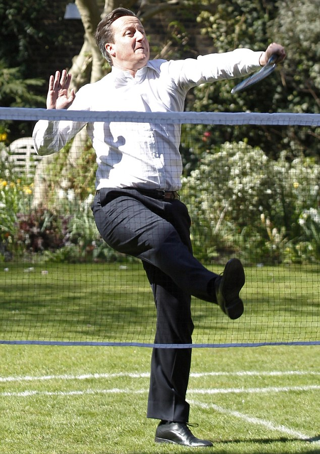 Full stretch: The Prime Minister struggles for balance as he smashes the shuttlecock during a game of badminton in the garden of no. 10