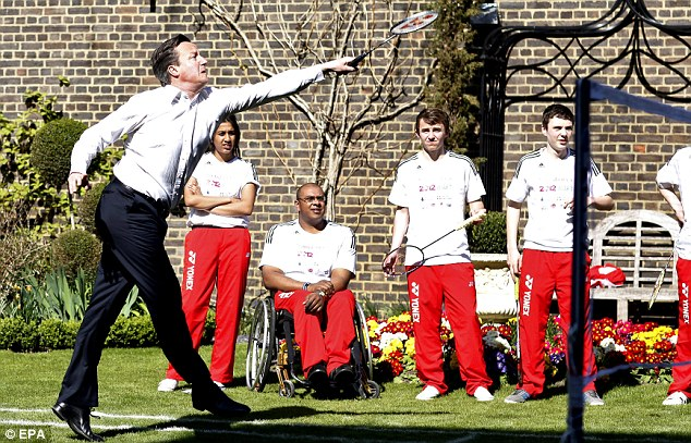 Wish I'd worn a t-shirt: The PM stretches for a shot in front of a group of young players