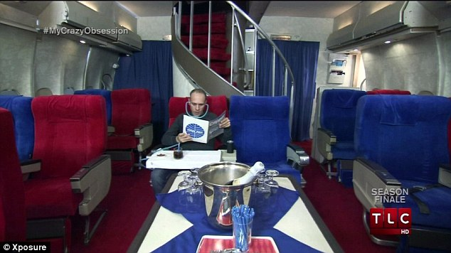 Cabin fever: Mr Toth says his favourite part of his replica Pan Am cabin is a staircase from an original airliner