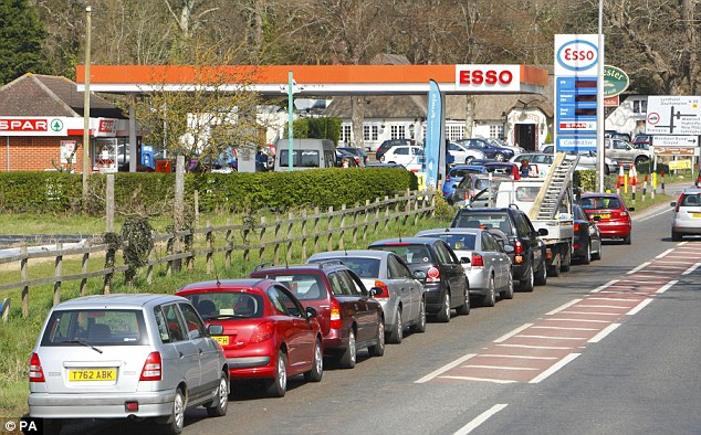 Hazard: Queues like this one on a main road in Christchurch, Dorset, led to police ordering the closure of the county's garages for safety reasons
