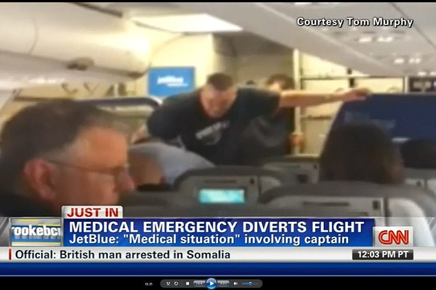 The captain was subdued thanks to the help of passengers on the flight 'packed with burly men' heading to the 2012 International Security Conference in Las Vegas