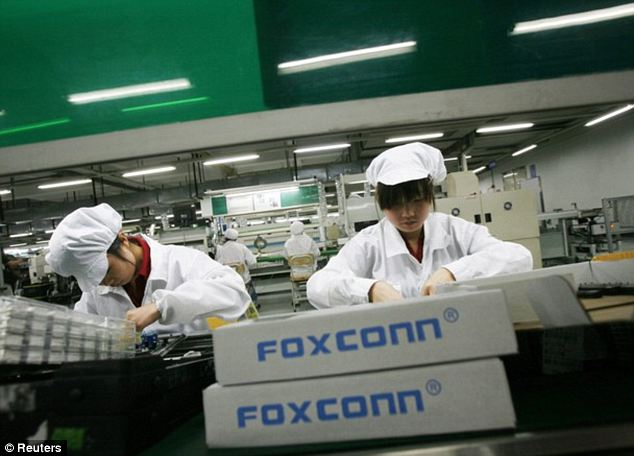 Workers inside a Foxconn factory in the township of Longhua in the southern Guangdong province