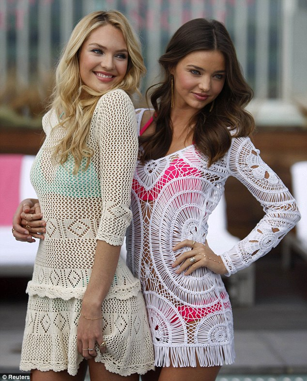 Crocheted cuties: Miranda and Caprice were forced to cover up their enviable figures because of the chilly LA morning