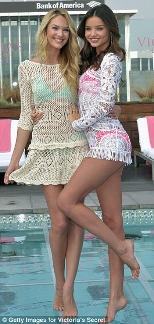 Bathing belles: Miranda was joined at the launch by fellow Victoria's Secret model Candice Swanepoel who also kept covered in a cream crocheted top