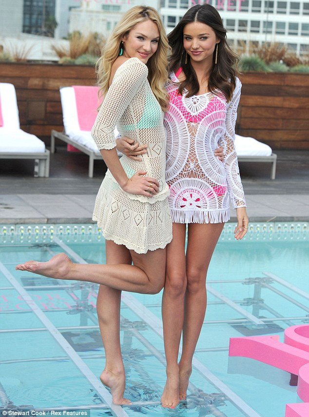 Pins on parade: Miranda and Candice showed off their long toned legs as they posed for photos in the pool