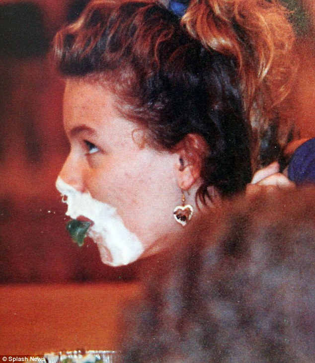 Creaming the competition: The fun loving girl got her face covered in cream while taking part in a jelly bean eating contest