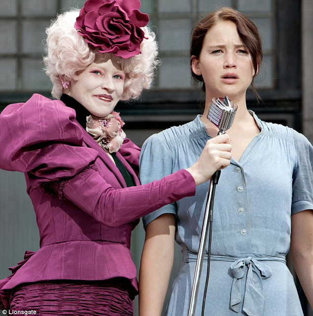 Screen star: Elizabeth as Effie Trinket in The Hunger Games, alongside Jennifer Lawrence as Katniss Everdeen