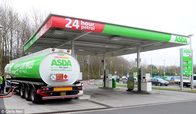 A fuel tanker stocks up the pumps at a filling station in Aintree, Liverpool, that had run dry after two days of panic buying