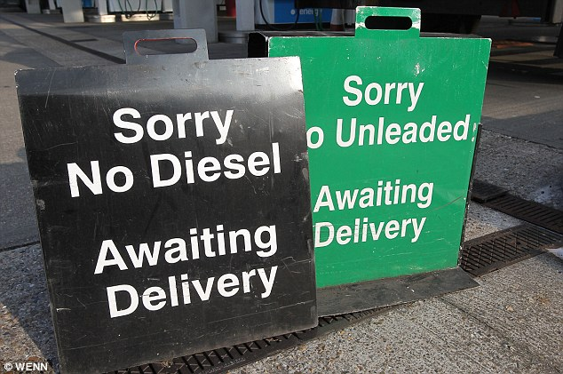 Running on empty: An Esso petrol station near Hammersmith Bridge, Barnes, is closed today as the fuel crisis grips Britain
