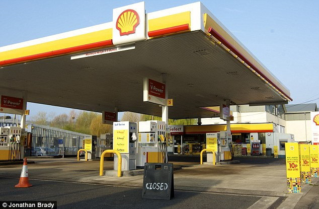 Deserted: A Shell garage forecourt displays a closed sign to customers in High Wycombe, Buckinghamshire, today as uncertainty about fuel strikes continues