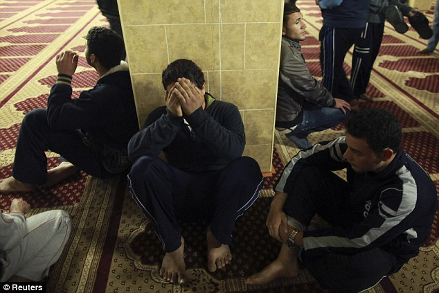 Ceremony: Palestinians mourn 21-year-old Mr Zaqout at the mosque during his funeral