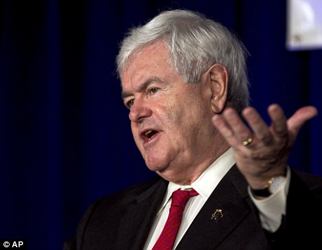 Hanging in there: Newt Gingrich's camp are now talking of a shared Gingrich-Santorum ticket