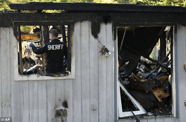 Devastation: The burnt-out shell of the house where Josh Powell killed himself and his sons
