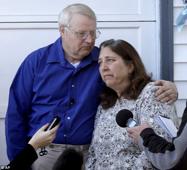 Grieving: Mrs Powell's parents Chuck and Judy Cox outside their home after their grandsons' death
