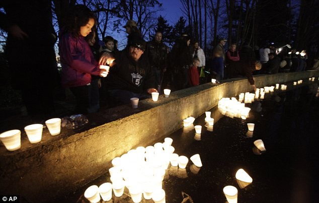 Vigil: Mourners pay tribute to Braden and Charlie in Tacoma, Washington after their death in February