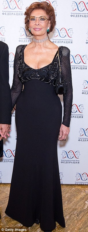 Glamorous: Sophia was joined by Paula Abdul at the event, who also wore a floorlength gown but in white
