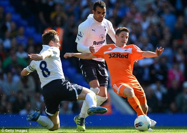 Midfield scrap: Parker and Sandro close down Swansea's Allen