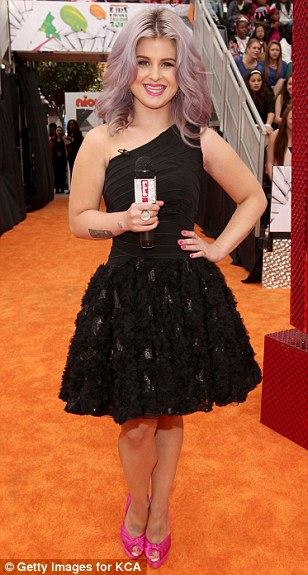 Work and play: Kelly was on the red-carpet to get underway with hosting duties for E! Entertainment