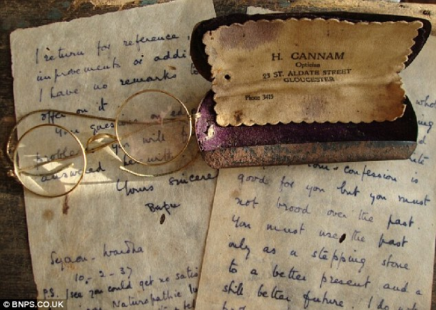 Gandhi's distinctive round-lensed spectacles and handwritten letters
