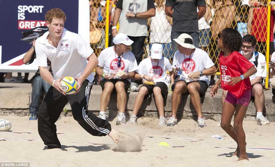 Playful prince: Harry also found time to play rugby and volleyball on the Praia De Flamengoe in Rio De Janeiro during his tour of Brazil