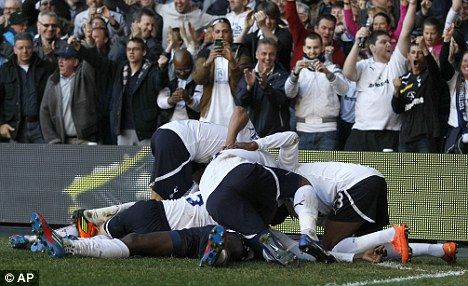 Back in the groove: Tottenham celebrate as they beat Swansea