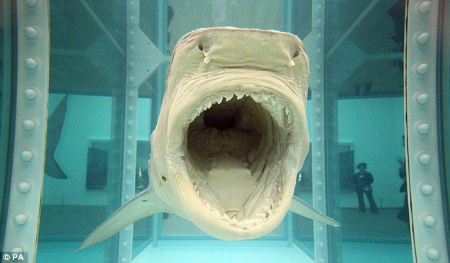 Prices that bite: Hirst's famous shark suspended in formaldehyde is also on display at the Tate Modern
