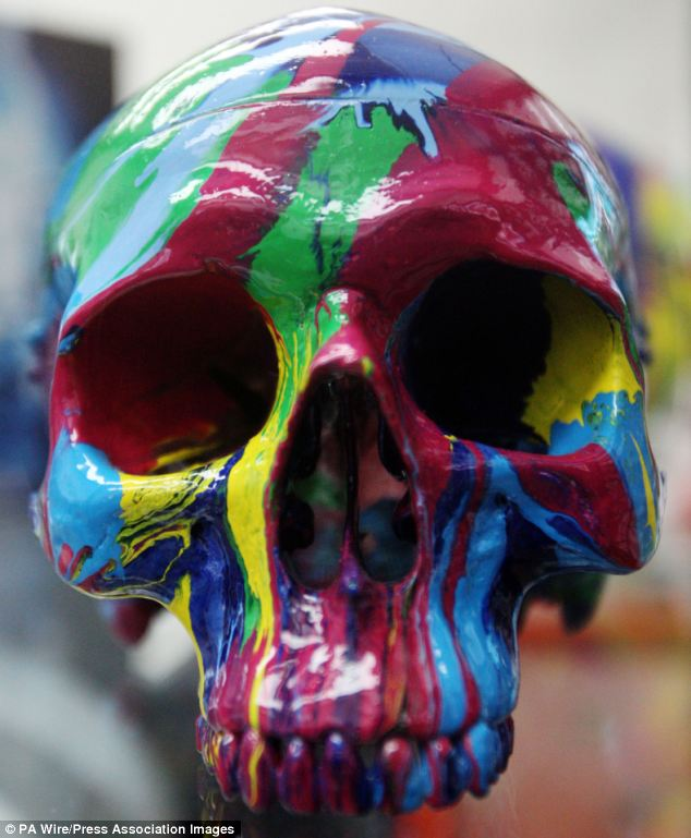 Hallucinatory Head: One of Damien Hirst's replica plastic skulls for sale at the Tate Modern gift shop with a price tag of £36,800