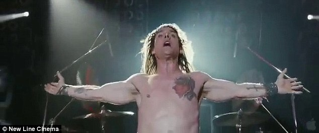 Rock star: Tom Cruise strips off and belts it out in a new extended trailer for Rock Of Ages