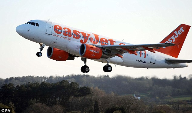 On the cheap: Prince William kept costs down by flying with easyJet from Geneva to Manchester