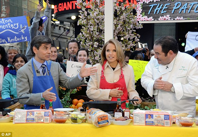 Getting stuck in: Couric, pictured on Tuesday's show with Stephanopoulos and chef Emeril Lagasse, has been praised for her hosting on the show, which comes six years after she left NBC