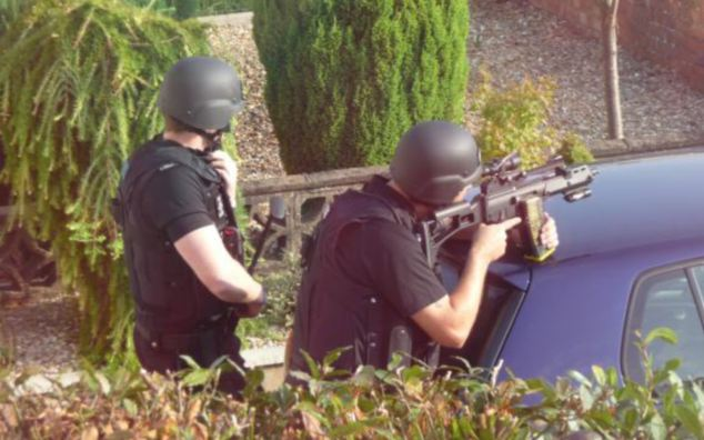 Armed police took up posts outside Searle's house during the stand off but after eight hours they discovered he was holding a fake gun