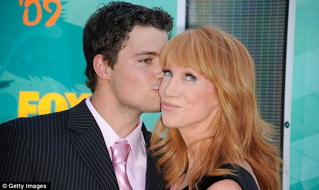 Couple? Comedienne Kathy Griffin gets a smooch from Johnston, her date for the 2009 Teen Choice Awards, outside the event