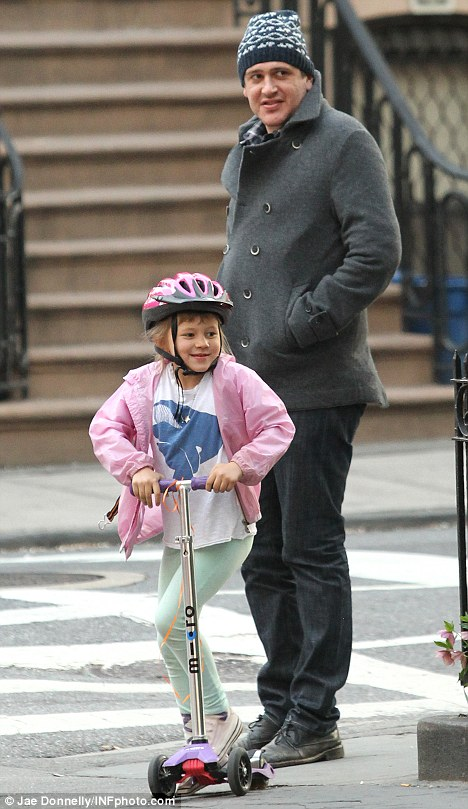 Playing the doting daddy role: The next day Jason was spotted spending time with Michelle's six-year-old daughter Matilda