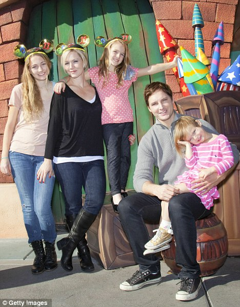 Stayed quiet for the children: Luca, Lola and Fiona with their parents at Disneyland California in 2010