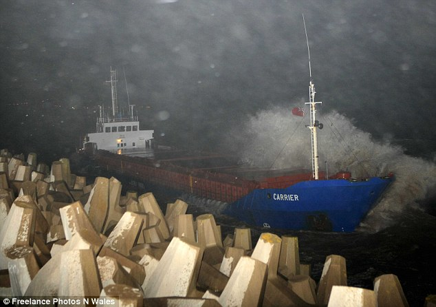 On the rocks: The boat, carring a cargo of stone, crashed against the rocks at Colwyn Bay