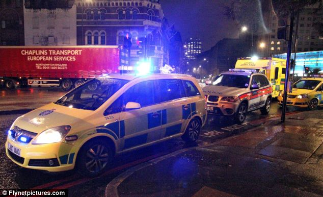 Overshadowed: Emergency services lined the street outside the event that had been intended to promote BlackBerry's instant messenger service