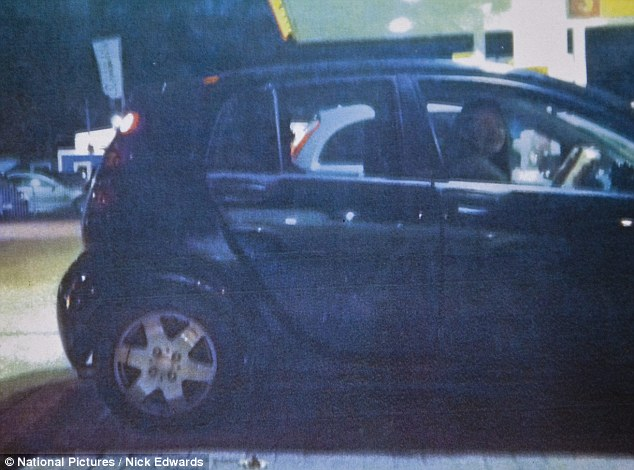 Smiling: Jurors were shown a picture of Laura Johnson as she drove her car on the night of the looting
