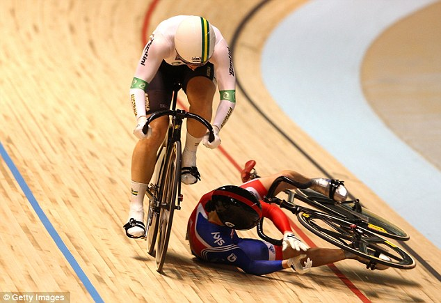 Down: Victoria Pendleton crashes in her Sprint semi-finals race with Australia's Anna Meares