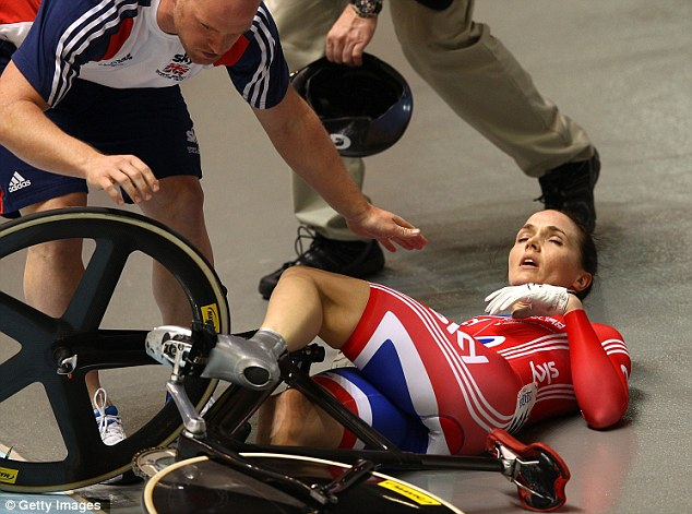 Helping hand: Pendleton by her team after crashing