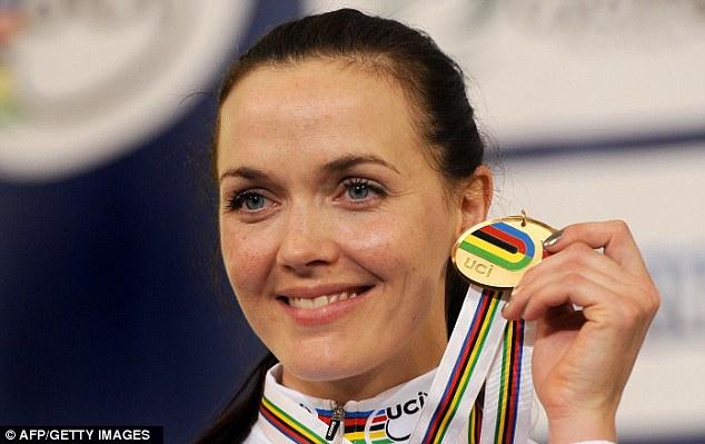 Golden girl: Victoria Pendleton shows off her gold medal