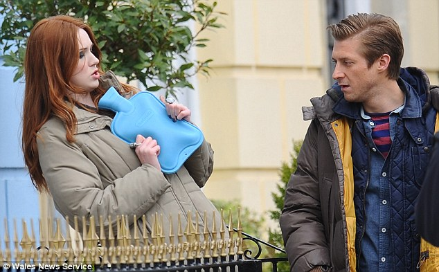 Feeling chilly? Gillan and Darvill kept warm in padded coats plus the redhead carried a hot water bottle
