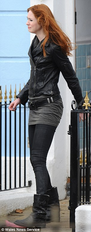 Biker chick: Gillan was wearing a black leather jacket, matching boots and dark leggings to shoot one of her last episodes